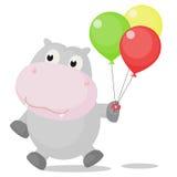 与五颜六色的气球的愉快的河马 免版税库存图片