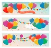 与五颜六色的气球的节假日横幅 免版税库存照片