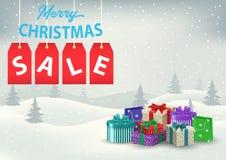 与五颜六色的礼物的圣诞节销售海报在背景 免版税图库摄影