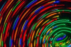 与五颜六色的背景的照相机运动的抽象轻的绘画 图库摄影