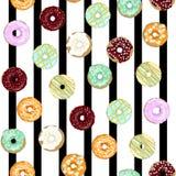 与五颜六色的釉的甜油炸圈饼 库存照片