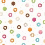 与五颜六色的鲜美光滑的油炸圈饼的无缝的样式 免版税库存照片