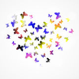 与五颜六色的蝴蝶的抽象背景以心脏形式 免版税库存照片