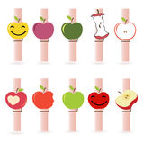 与五颜六色的funy苹果传染媒介的晒衣夹 库存图片
