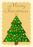 与五颜六色装饰的圣诞树的圣诞快乐 库存照片