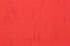 与亚麻制结构的红色织品 库存照片