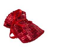 与亮晶晶的小东西的红色礼物袋子 库存照片