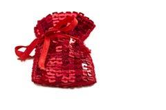 与亮晶晶的小东西的红色礼物袋子 免版税库存图片