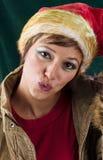 与亲吻的逗人喜爱的圣诞老人 库存照片