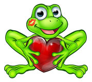 与亲吻和爱心脏的动画片青蛙 图库摄影