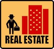 与人和城市的房地产标志 免版税库存图片
