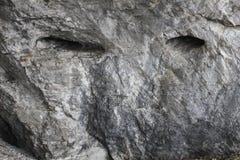 与人的神色的岩石 异想天开自然 免版税库存照片