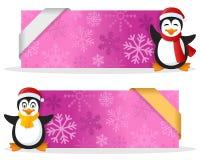 与企鹅的桃红色圣诞节横幅 免版税库存照片