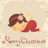 与休眠新出生的天使的圣诞卡 库存照片