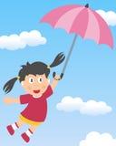与伞的小女孩飞行 免版税库存图片