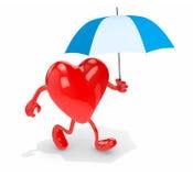 与伞的心脏 免版税库存照片