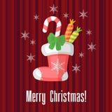 与传统袜子或长袜的圣诞卡 库存照片