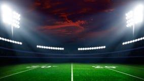 与体育场光的橄榄球场 免版税库存照片
