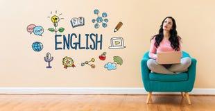 与使用膝上型计算机的妇女的英语 免版税库存照片