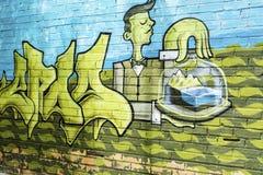 与侍者人的绿色艺术街道画 免版税库存图片