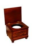 与便壶的老洗手间一把木椅子 免版税库存照片