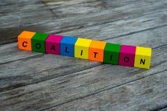 与信件的色的木立方体 词联合被显示,抽象例证 免版税库存图片