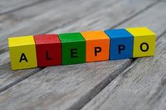 与信件的色的木立方体 词阿勒颇被显示,抽象例证 免版税库存照片