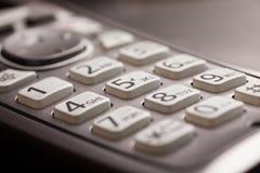 与信件特写镜头宏指令射击的电话键盘 库存图片