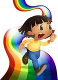 与儿童使用的一条彩虹 免版税库存照片