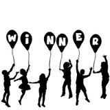 与儿童剪影和气球的优胜者概念 免版税图库摄影