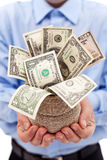 与充分货币袋子的生意人美元 免版税库存照片