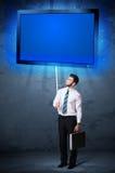 与光亮的片剂的商人 免版税图库摄影