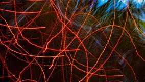 与光亮红色小条的抽象背景 库存照片