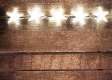 与光和大方的本体空间的圣诞节土气背景 Fes 免版税库存照片