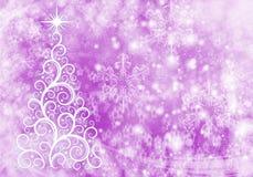 与光和雪花的圣诞节抽象背景 免版税库存照片