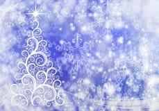 与光和雪花的圣诞节抽象背景 库存图片