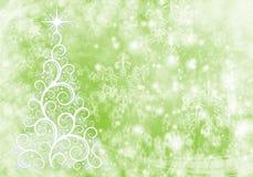 与光和雪花的圣诞节抽象背景 库存照片