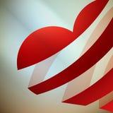 与光的丝带红色心脏。 免版税图库摄影