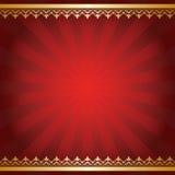 与光芒和金黄装饰品的明亮的红色背景 免版税库存图片