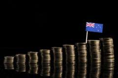 与全部的新西兰旗子在黑色的硬币 库存图片