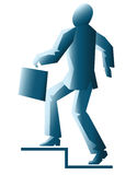 与公文包的被简化的商人 免版税库存图片