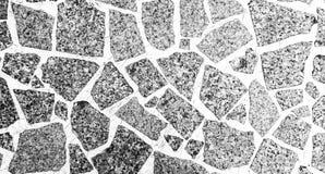 与具体纹理或backgroun的黑白堆花岗岩 库存图片