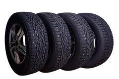 与冬天轮胎的四个圆盘 免版税库存照片