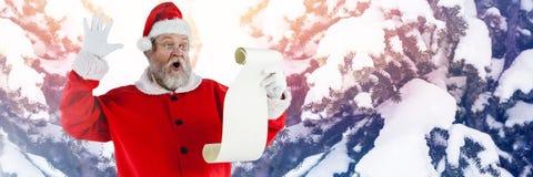 与冬天风景书单的圣诞老人 免版税库存图片
