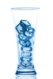 与冰和水下落的典雅的高玻璃 图库摄影