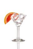 与冰块和桔子的玻璃 免版税库存照片