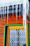 与冰柱的污迹玻璃窗 免版税库存图片