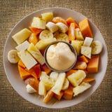 与冰淇凌的热带水果沙拉 库存图片