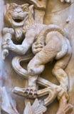 与冰淇凌的著名生物在石头雕刻了;萨拉曼卡,西班牙新的大教堂的带复杂花叶形装饰的样式雕塑  免版税库存照片