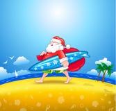 与冲浪板的圣诞老人 免版税图库摄影